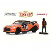 Miniatura Carro Nissan GT-R (2011) #11 c/ Figura - The Hobby Shop - Series 3 - 1:64 - Greenlight